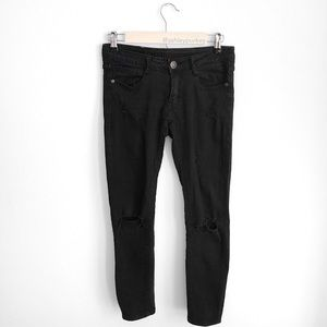 Black distressed skinny jeans